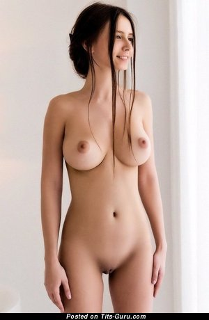 Sexy topless brunette with medium natural boobies picture