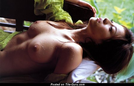 Image. Wet topless brunette with medium natural breast pic