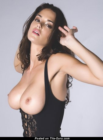 Nude brunette with medium natural breast photo