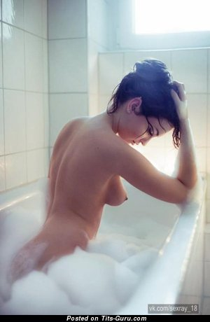 Image. Wet brunette with medium natural boob picture