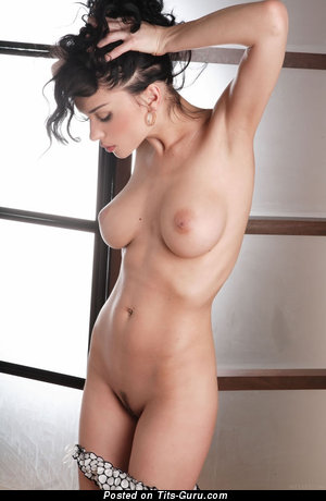 Jenya D - naked brunette with medium natural tits pic
