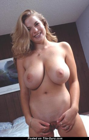 Dazzling Gal with Superb Bare Natural G Size Tots is Undressing (Porn Pic)