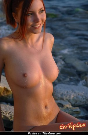 Image. Sexy wet naked red hair with medium natural boobs pic