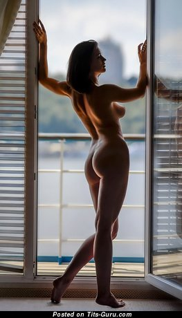 Image. Naked brunette with medium tittes image