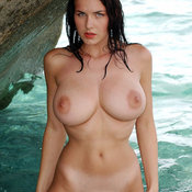 Wet brunette with huge natural boobies picture