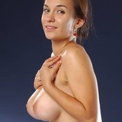 Topless brunette with medium natural boobs photo