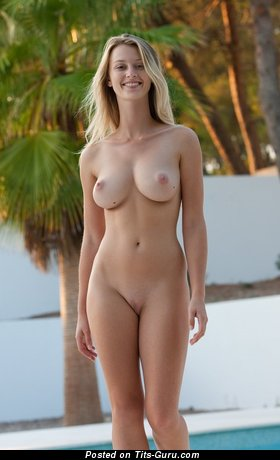 Sexy nude blonde with medium natural boob and big nipples image