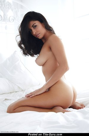 Image. Naked brunette with medium natural breast photo