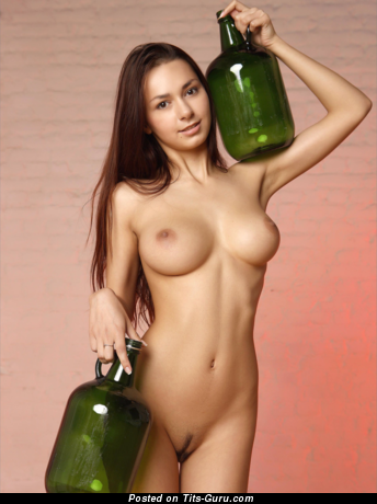 Image. Sexy topless brunette with medium natural boobs and big nipples photo