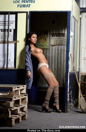 Image. Naked beautiful woman with medium fake breast photo