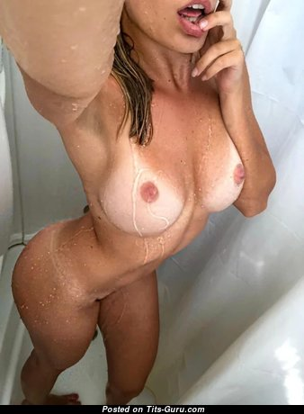 Good-Looking Brunette Babe with Good-Looking Bare Real Knockers in the Shower (Xxx Photo)
