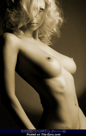 Image. Naked blonde with medium natural breast pic