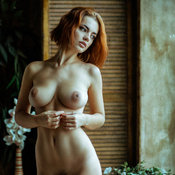 Red hair with big natural boobies image