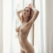 Sexy topless blonde with medium natural boobs photo
