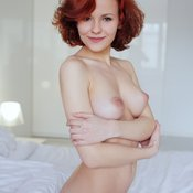 Red hair with medium natural boobs picture