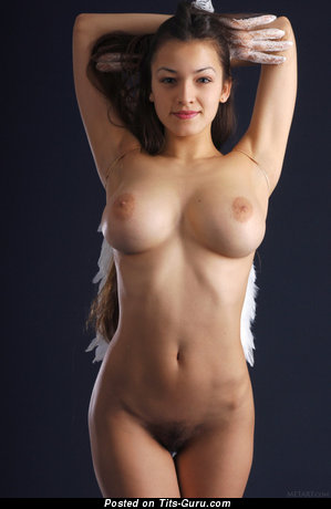 Image. Sofi A - sexy topless brunette with medium natural boob photo