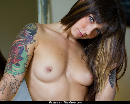 Image. Nude brunette with small natural tittes and tattoo picture