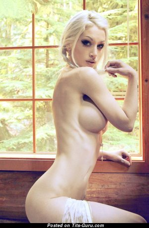 Naked hot woman with medium fake boobs pic
