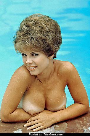 Image. Nude blonde with big fake tots vintage
