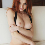 Red hair with natural boob image