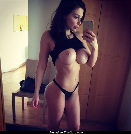 Image. Topless brunette with big fake boobs selfie