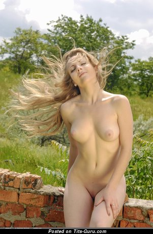 Image. Nadya - naked blonde with medium natural boobs photo