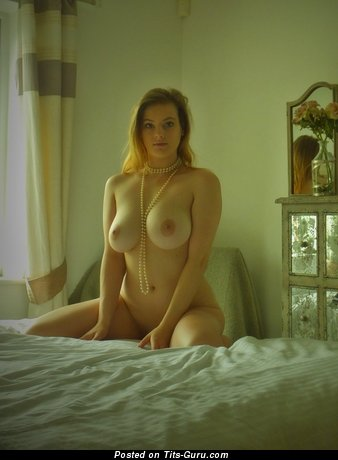 Lotty - sexy amateur naked red hair with medium natural breast and big nipples photo