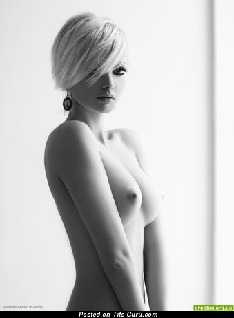 Image. Nude blonde with medium natural tots photo