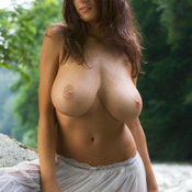 Nice woman with huge natural breast photo