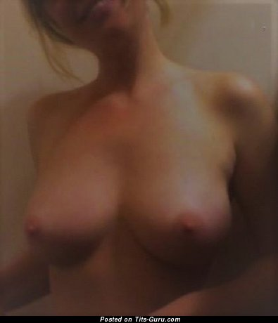 Sexy topless amateur blonde with big nipples pic