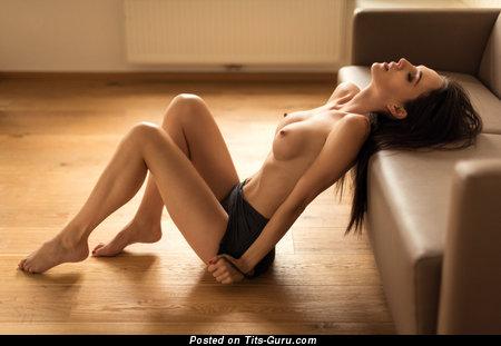 Image. Bianka - naked brunette with medium fake boob photo