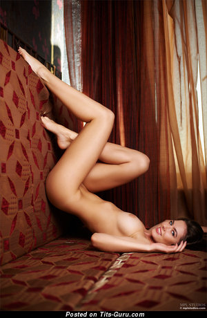 Image. Arianna - naked brunette with medium natural breast picture
