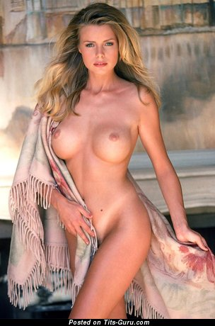Image. Anne Marie Goddard - naked blonde with medium fake boobs image