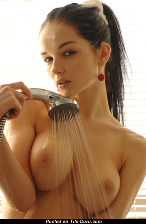 Wet naked nice lady with big natural tittes image