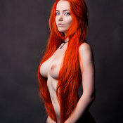 Red hair with medium natural tits photo