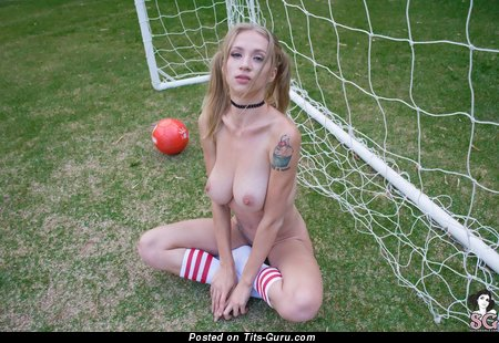 Nude blonde with natural tots and tattoo image