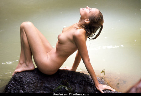 Ursula Andress - nude nice woman with medium natural boobs image