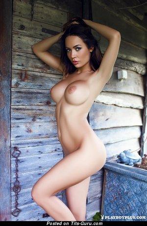 Image. Naked brunette with fake breast photo
