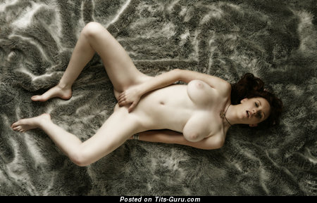Image. Naked brunette with huge natural boobies image