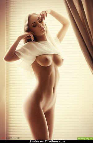 Image. Nude blonde with medium natural tittes pic