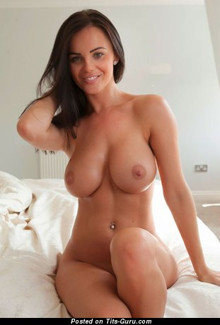 Image. Nude brunette with medium natural tittes pic