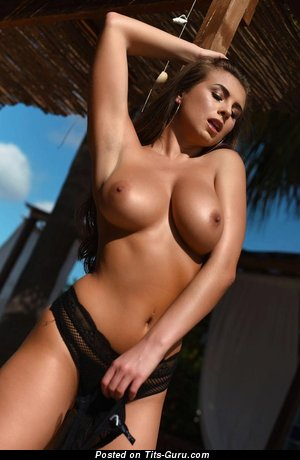 Sexy naked brunette with medium tits pic