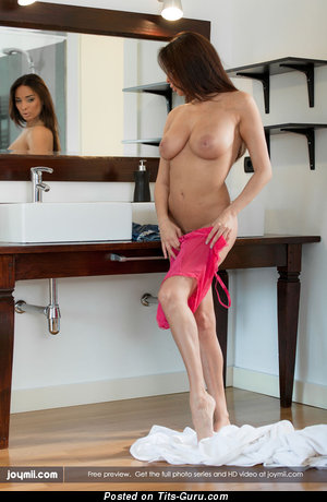 Image. Anissa Kate - topless brunette with medium natural boobies image