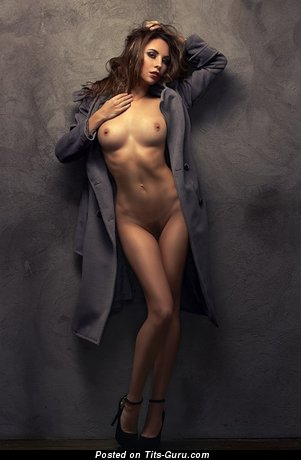 Image. Nude awesome female with medium tots pic