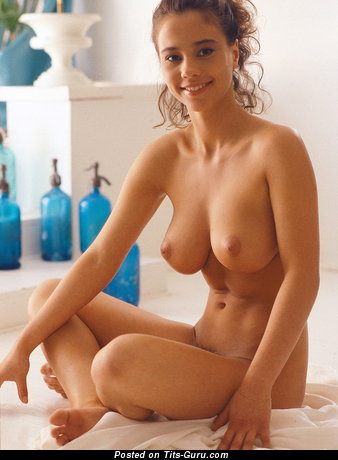 Image. Naked brunette with medium natural boob pic