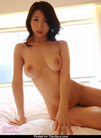 Julia Boin: topless asian brunette with big natural boobies image