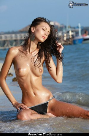Image. Wet topless brunette with medium natural tittes picture