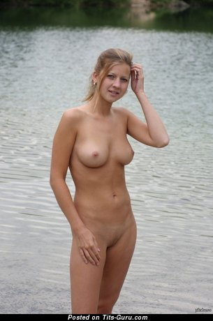 Image. Naked amazing girl with medium natural tots picture