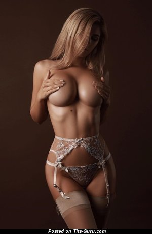 Sexy naked blonde with medium tots image