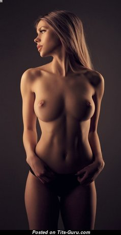 Topless brunette with medium natural tittes image